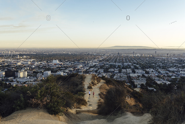 Runyon Canyon Trail, Los Angeles, CA, USA - November 9, 2019: View of Los Angeles and Runyon canyon trail - horizontal with people on trail 2