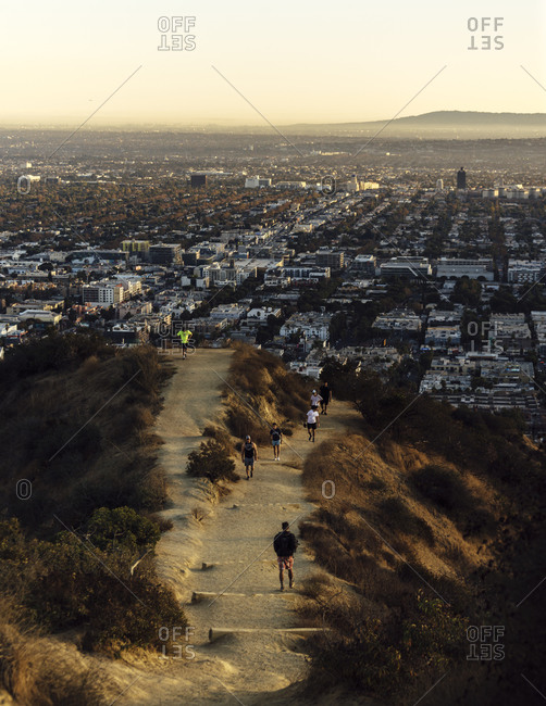 Runyon Canyon Trail, Los Angeles, CA, USA - November 9, 2019: View of Los Angeles and Runyon canyon trail - horizontal with people on trail 3
