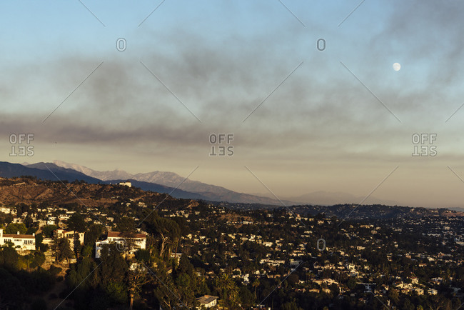 View of Los Angeles at sunset with moon