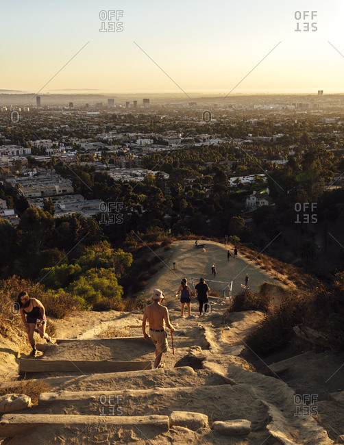 Runyon Canyon Trail, Los Angeles, CA, USA - November 9, 2019: View of LosAngeles and people hiking up Runyon Canyon Trail vertical 1