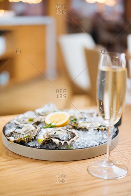 Champagne and delicious oysters on Ice cube on a plate in a restaurant