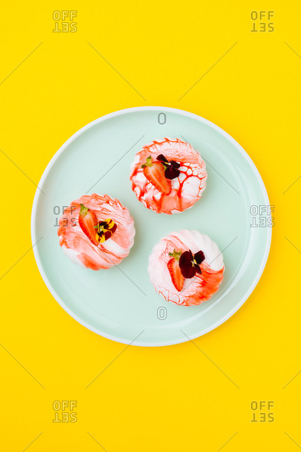 Tasty desserts with strawberries and flowers