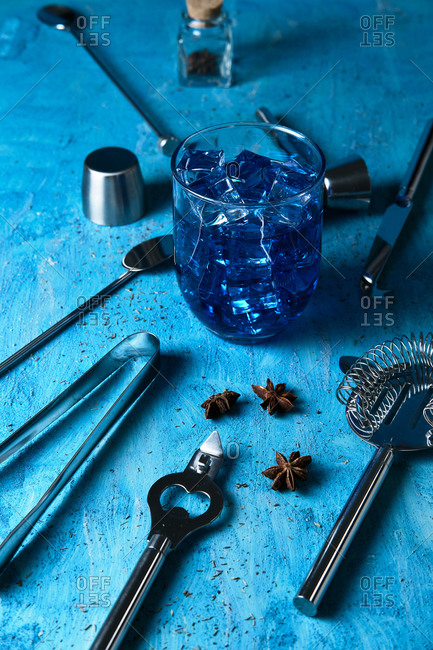 Blue drink and bartender tools on table