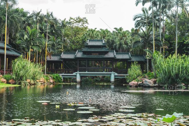 June 26, 2018: June 26, 2018: Landscape of old oriental building on lake