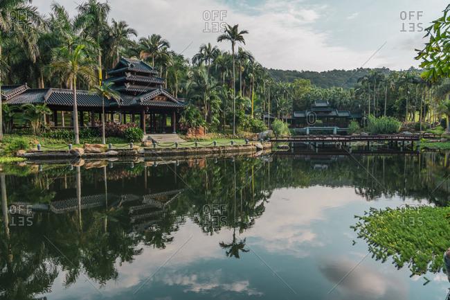 June 26, 2018: June 26, 2018: Landscape of tranquil lake in exotic park