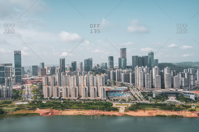 June 26, 2018: June 26, 2018: Cityscape of contemporary metropolis on river shore