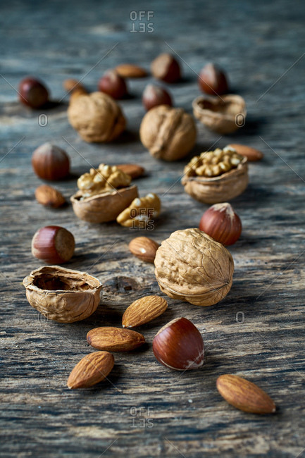 Brown ripe hazelnut and walnut at table