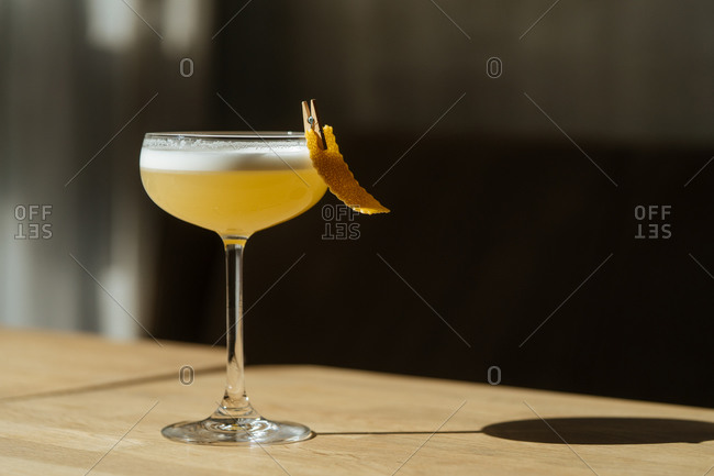 Fresh appetizing cocktail in glass festively decorated with clothespin