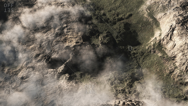 Computer generated illustration of clouds over mountainous terrain