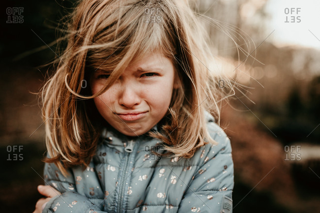 Young girl pouting on a cold day