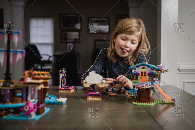 Young girl playing with toy blocks