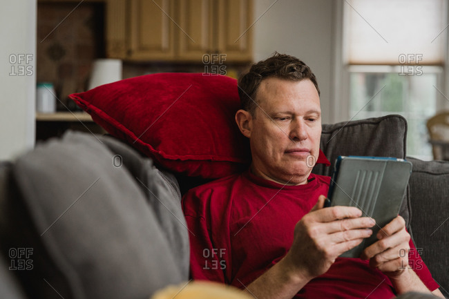 Man reading on a device