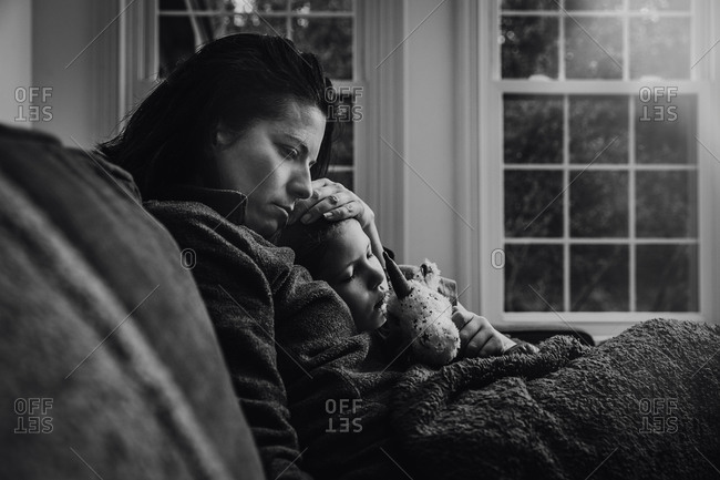 Mother and daughter sitting on the couch together in black and white