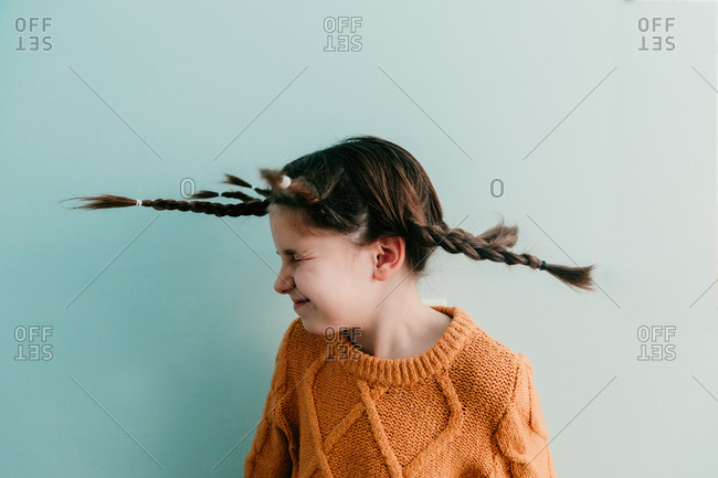 Girl with braids shaking her head