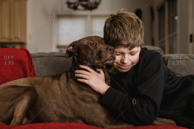 Boy with his dog on the couch