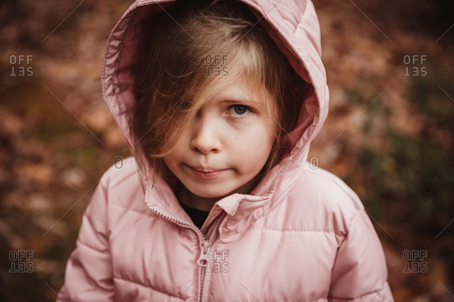 Portrait of girl in a pink jacket