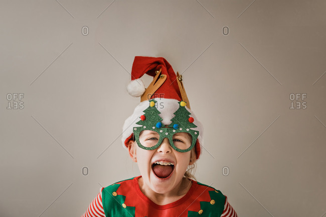 Little girl dressed up in a funny Christmas outfit