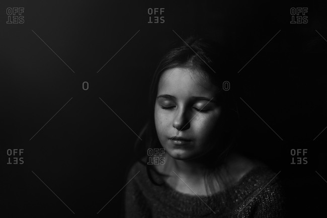 Serene portrait of a girl in black and white