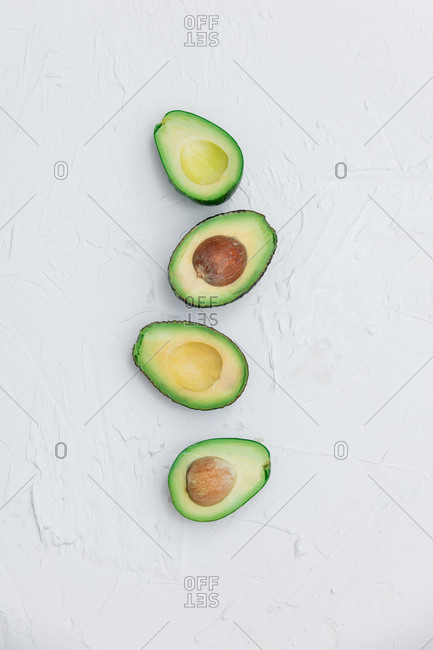 Avocado slices with a bone on a white background