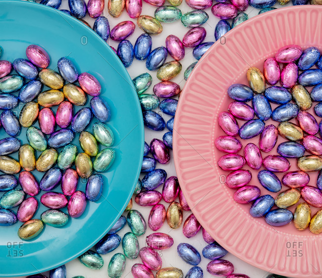 Chocolate Easter eggs in colored wrappers in plate