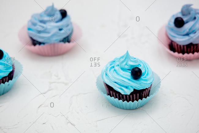 Chocolate cupcake with cream on white background