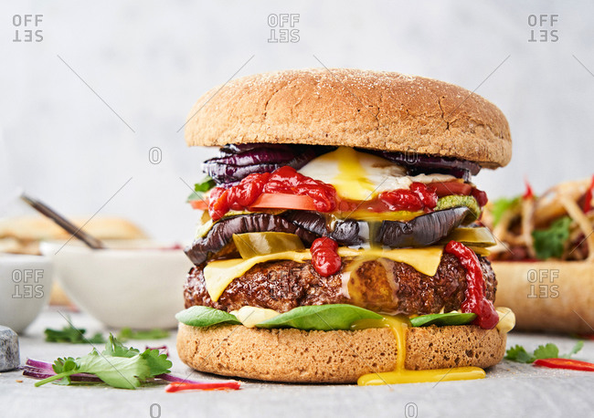 Cheeseburger dripping with egg yolk and ketchup