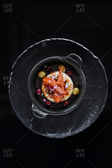 Overhead view of a gourmet dessert dish in a black dish