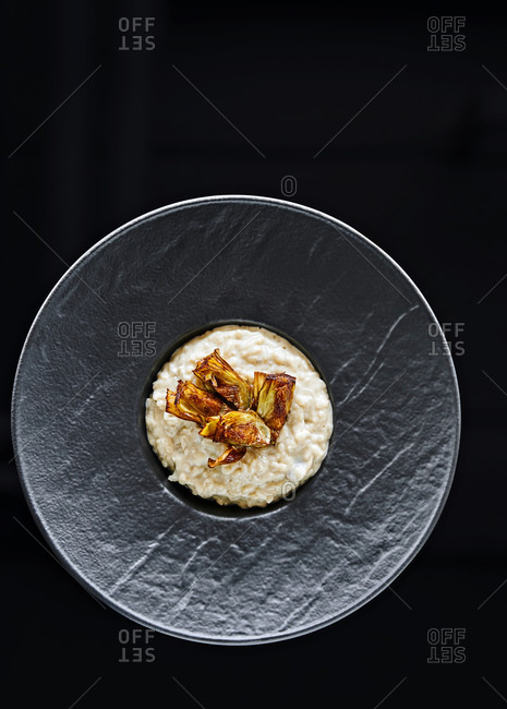 Risotto dish in a black bowl