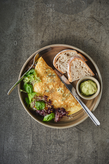 Overhead view of an egg omelet with lettuce and toast