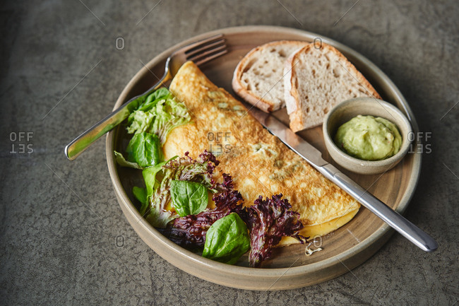 Egg omelet with lettuce and toast