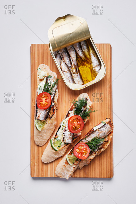 Sardines on bread with tomatoes and herbs