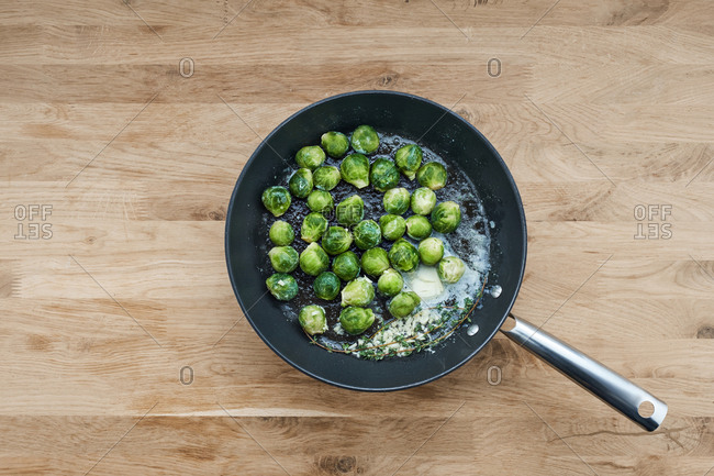 Brussels sprouts and thyme in a skillet