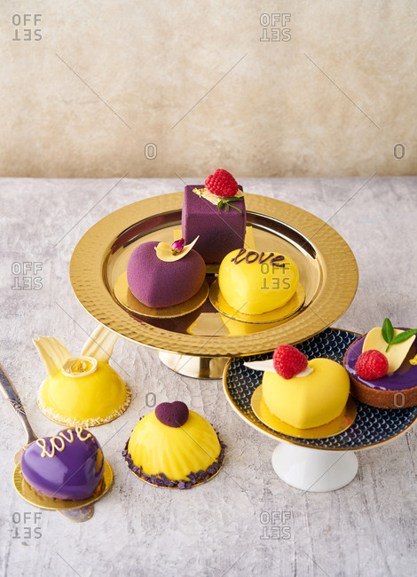 Variety of yellow and purple gourmet desserts