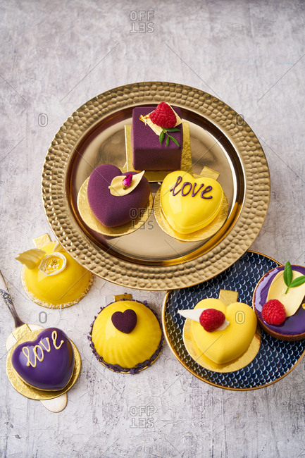 Overhead view of yellow and purple gourmet desserts