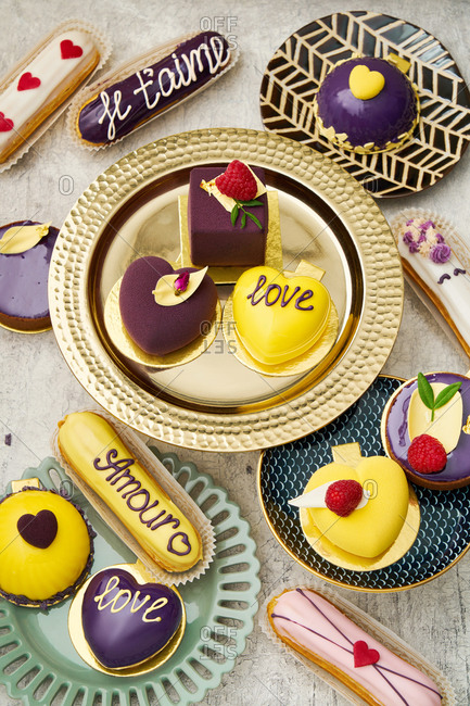 Yellow and purple Valentines cakes and eclairs