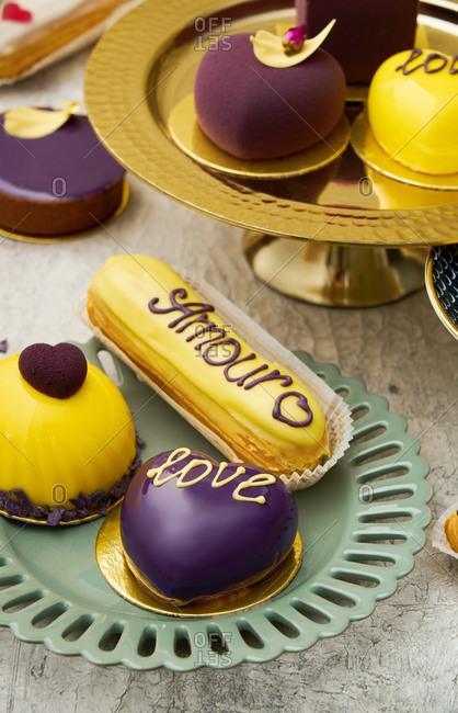 Close up of yellow and purple Valentines desserts