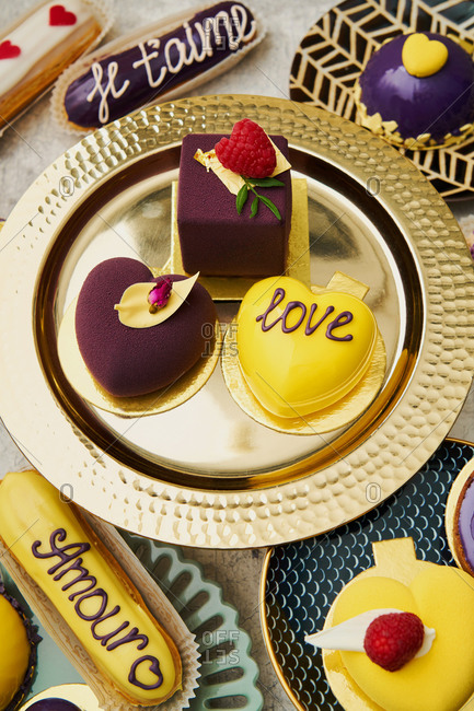 Top view of yellow and purple Valentines desserts