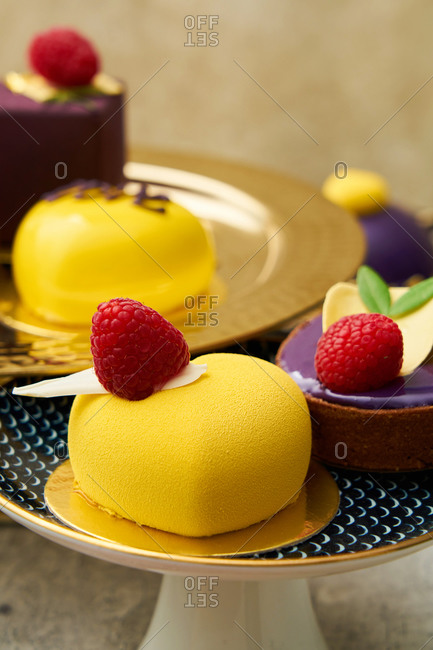 Close up of yellow and purple Valentine cakes