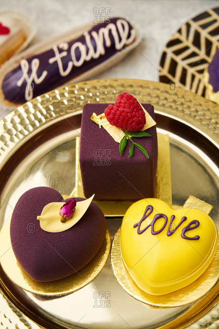 Top view of yellow and purple love-themed desserts
