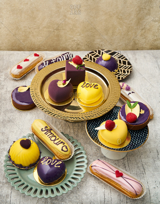 Various yellow and purple love-themed desserts