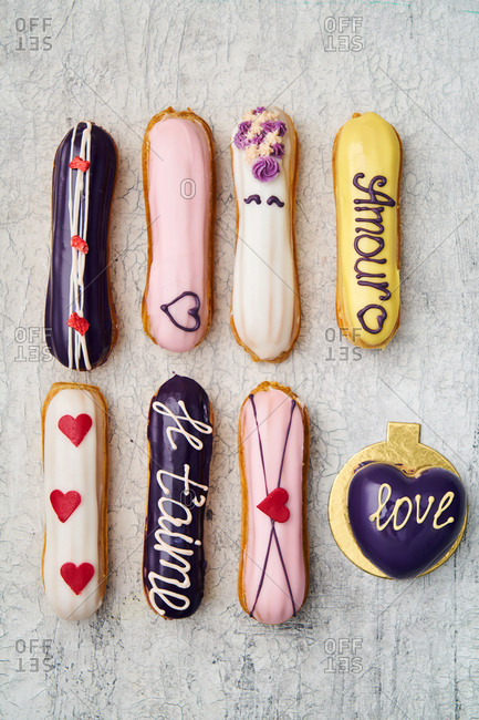 Valentines eclairs on light surface