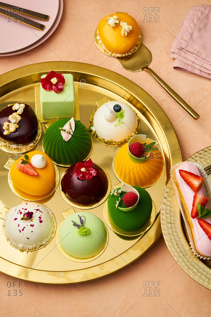 Colorful gourmet desserts on a gold tray
