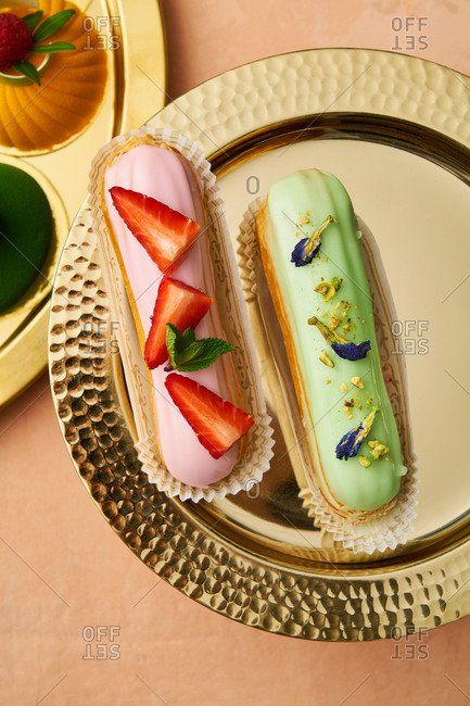 Eclairs on a gold tray
