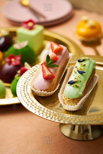 Close up of eclairs on a gold tray