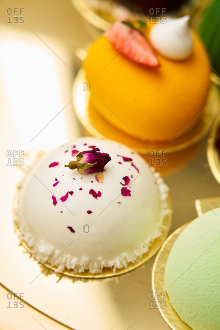 Gourmet miniature cakes on a gold tray