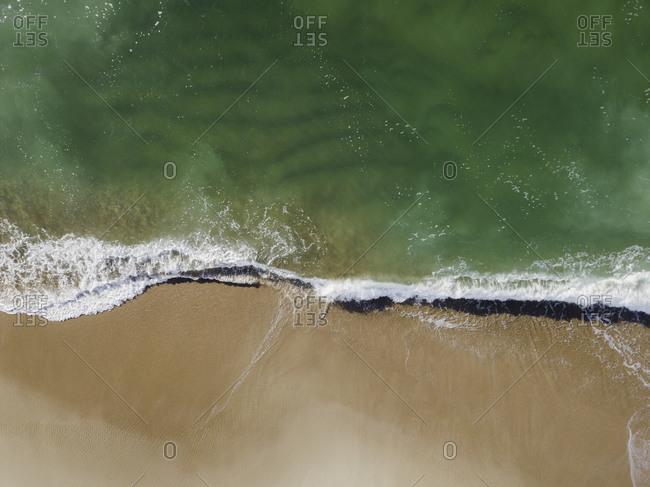 Clean ocean aerial over sandy New England beach in Rhode Island