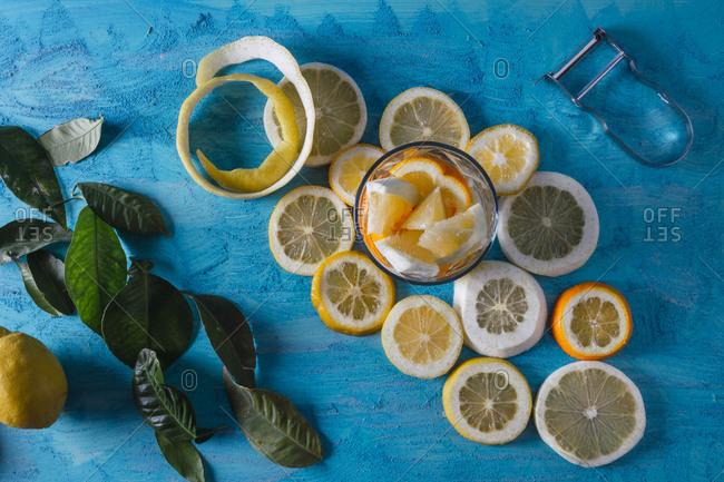 summer still life of lemon juice on a classic blue background