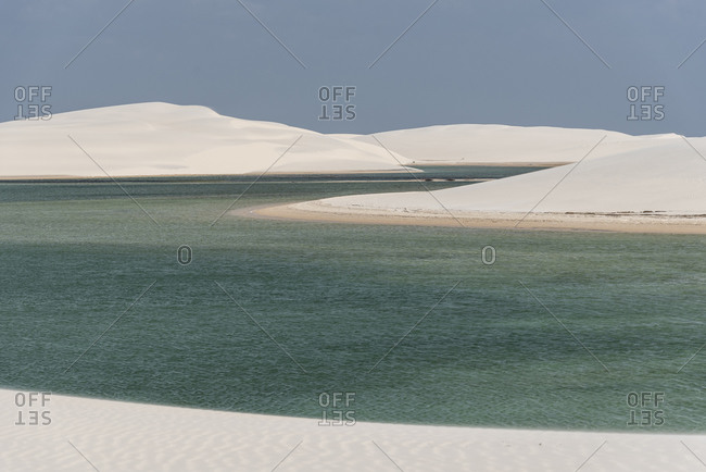 Beautiful view to white sand dunes and crystal clear rainwater pool