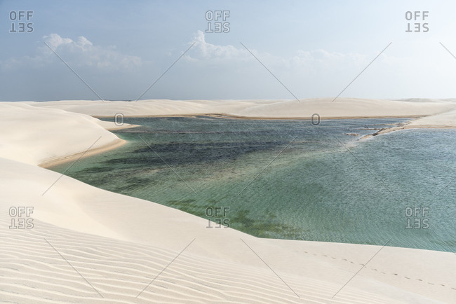 Beautiful view to white sand dunes and crystal clear rainwater lagoon