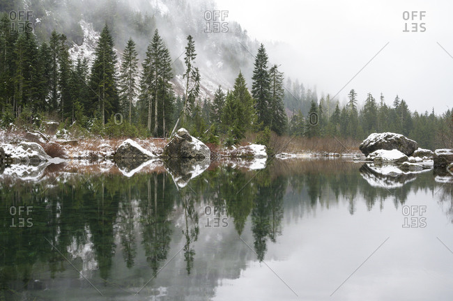 Alpine Lake Boulders and Trees Reflecting